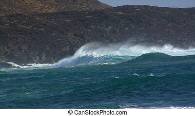 big cyan wave rolling spry crash