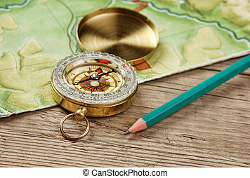 old map and compass on a wooden table
