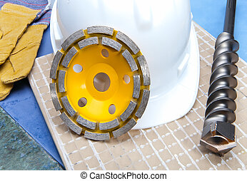 disks for concrete, drill and a helmet on a tile