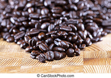 fair trade coffee bean - Coffee beans on wood table