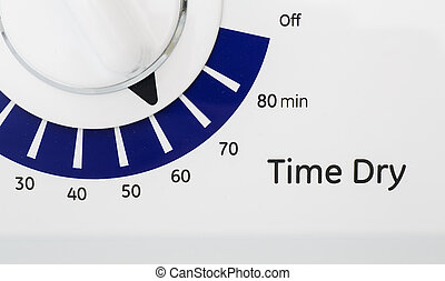 Timer on Dryer - Blue and white timer on a dryer set to 60...