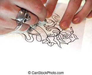 Tatto artist drawing sketch - Artist drawing sketch of...