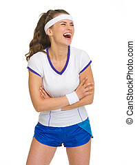 Portrait of laughing female tennis player