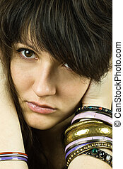 brunette lady with bracelets - closeup portrait of young...