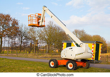 telescopic crane - an aerial platform for pruning trees with...