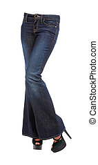 Young woman crossed legs in bell bottom jeans and platform...