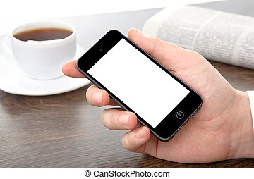 businessman hand holding a phone with isolated screen against the background of the table in the office