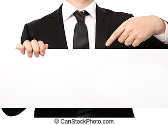 Isolated businessman in a suit holding a large white sheet of paper or banner