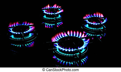 Gas Burners - Gas ring burner in the dark kitchen oven