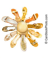 Sun shaped golden sandals still life fashion composition...