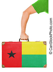The Guinea-Bissau Flag on a suitcase. Isolated on white.