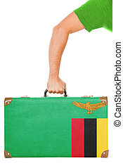 The Zambian flag on a suitcase. Isolated on white.