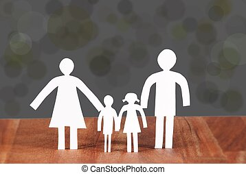 a family - a paper chain family sybolizing loneliness or a...