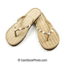 Raffia floral beaded flip flop sandals isolated on white...