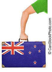 The New Zealand flag on a suitcase Isolated on white