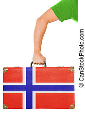The Norwegian flag on a suitcase. Isolated on white.