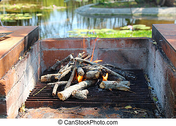 Starting a wood fired oven on a camping trip. Waterpond and...