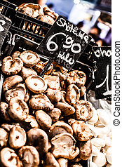 Heap of dried edible mushrooms on the market