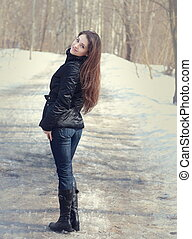 Beautiful woman smiling outdoors winter background