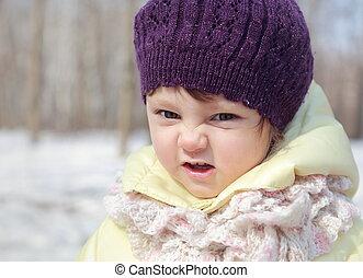 Fun baby in hat joy outdoor winter background