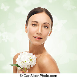 beautiful woman with white flower - portrait of beautiful...
