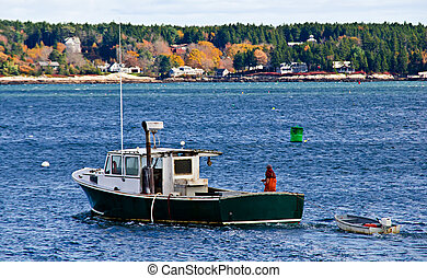 Lobster fishing boat with a fisherman against deep blue...