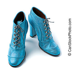 Sky blue metallized leather high heels booties isolated on...