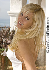 Blonde Woman Smiling close up - Blonde Woman holding wine...