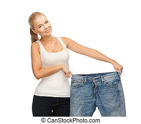 sporty, mulher, mostrando, grande, calças