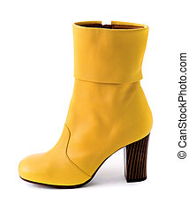 Elegant yellow leather boot with wooden heel isolated on...