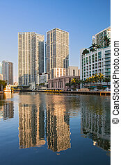 Miami Florida, Brickell and downtown financial buildings reflected over miami River on a beautiful summer day with blue sky