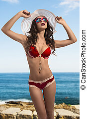 fashion girl in swimsuit with summer hat