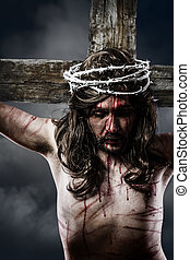 Jesus Christ with crown of thorns white on the cross of...