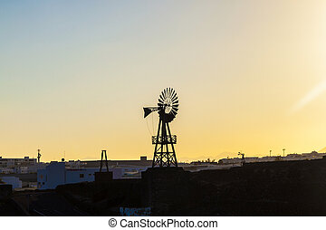 silhouette of old wind mill
