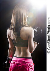 back muscled young female boxer