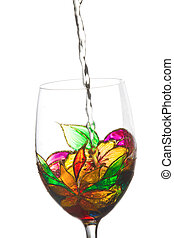 White wine poured in a beautiful painting stained glass