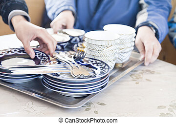 Tray with ware - The tray with ware is given on a table and...
