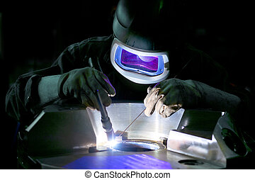Welder, working on the center ring of a large metal part