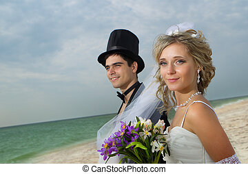 Wedding on beach - Glamour young couple resting on the beach