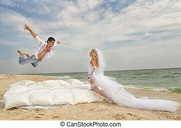 Wings of Happiness - Happy Groom flying on bed to his bride...