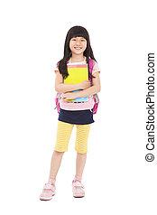 full length of asian little girl standing and holding books