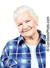young at heart - Happy senior woman smiling at the camera....