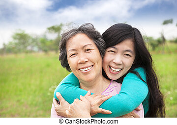 young woman hugging with her mother