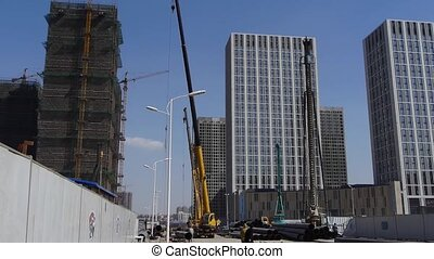 High crane & builder working in Construction site.
