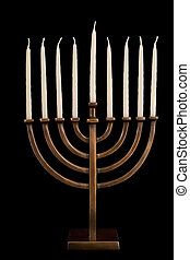 Beautiful unlit hanukkah menorah on black velvet. -...