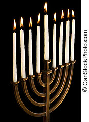 Beautiful lit hanukkah menorah on black background -...
