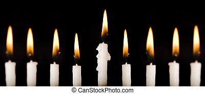 Beautiful lit hanukkah candles on black Super black...
