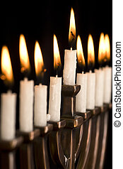 Beautiful lit hanukkah menorah on black. Super black...