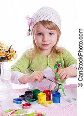 Girl painting eggs for Easter