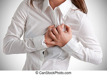 Woman in Pain - Woman having a pain in the heart area